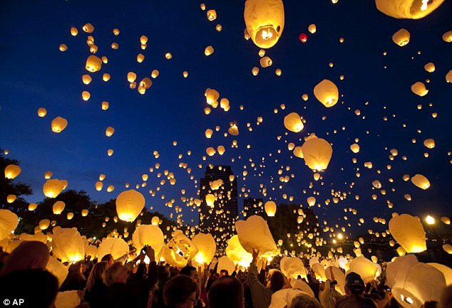 Chinese lanterns floating into the sky.  Credit: AP