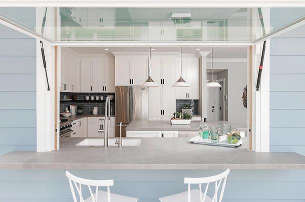 sleek kitchen remodel with pass through window