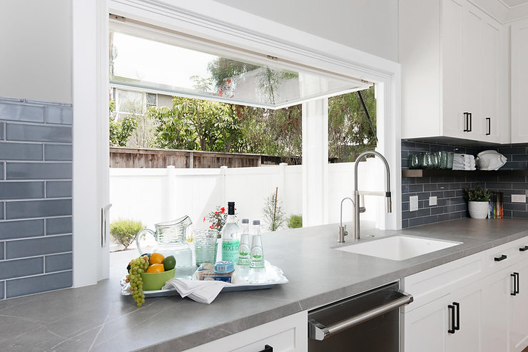 Kitchen window opens to outside patio