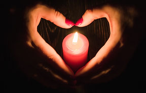 photo with heart hands and candle.jpg