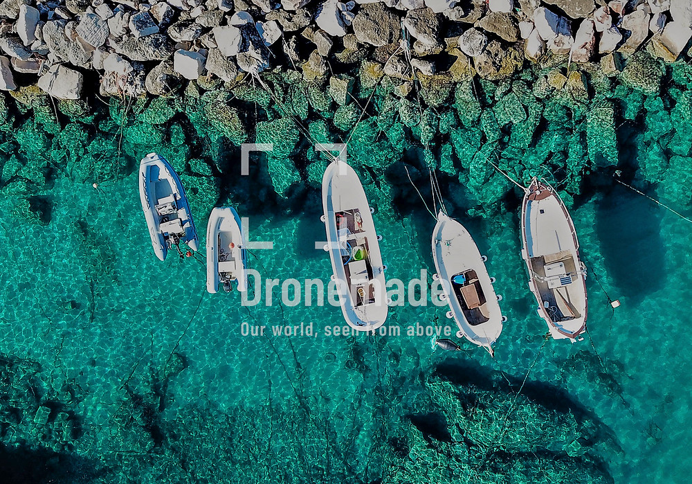 Small fishing boats viewed from a drone