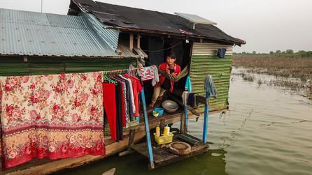 Aerial photo of young girl looking through her house boat