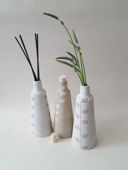 White and cream leaf vases