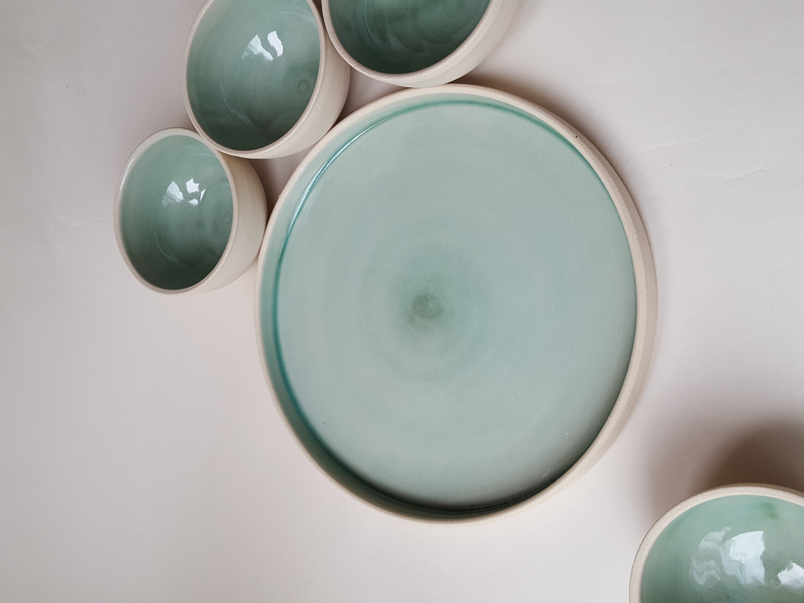 Small and shallow green bowls