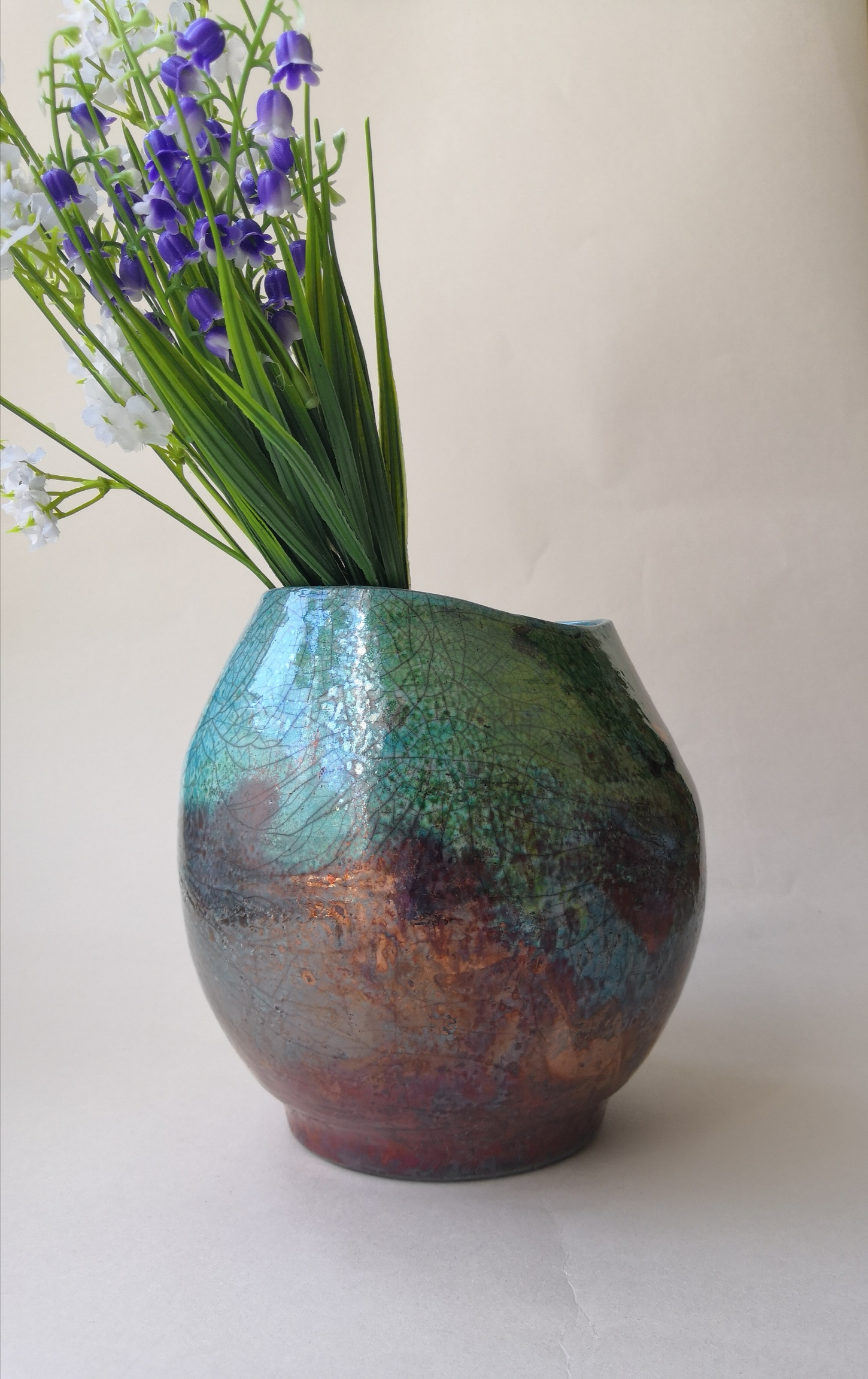 Belly shaped raku vase