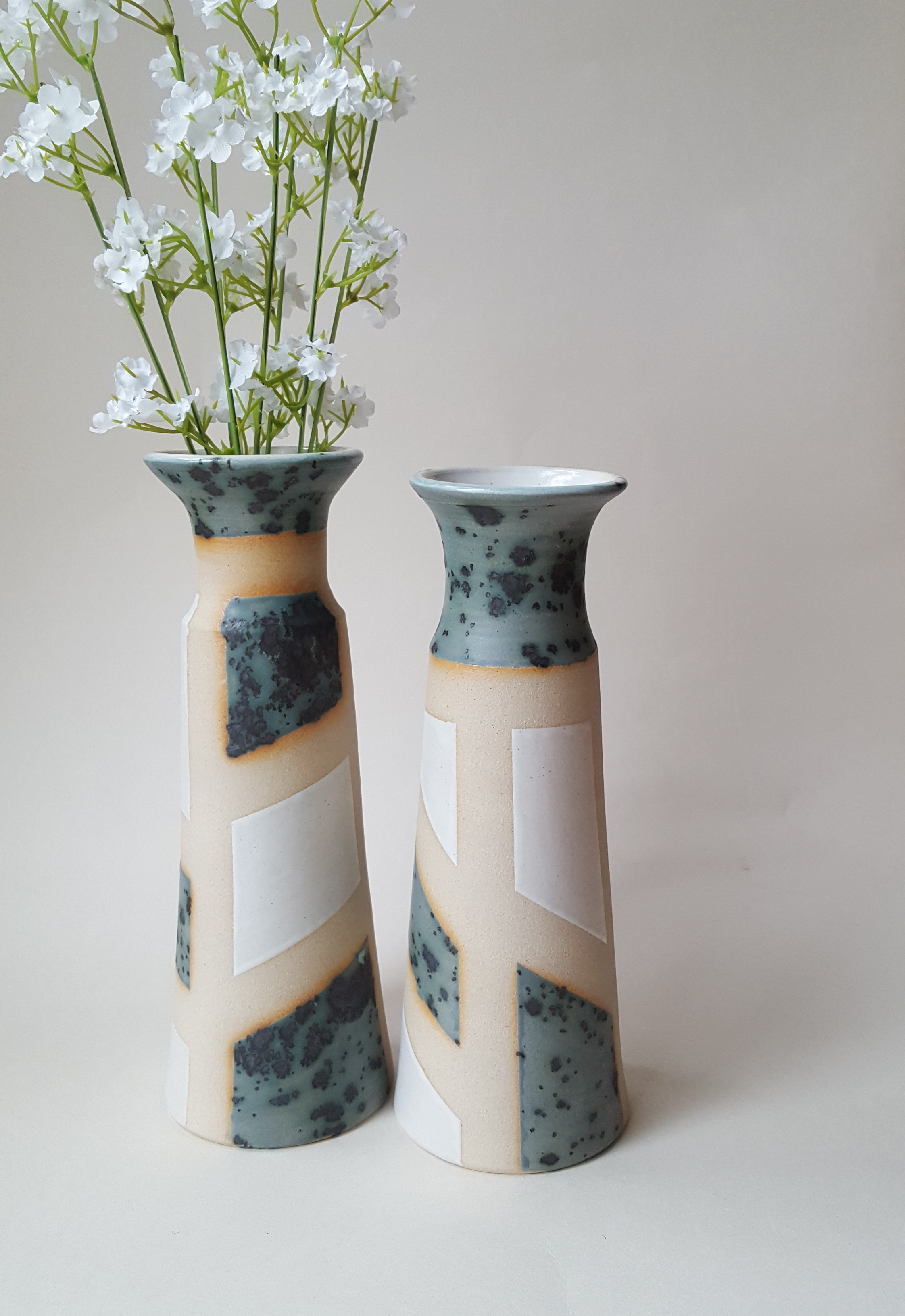 Tall green and white patchwork vases