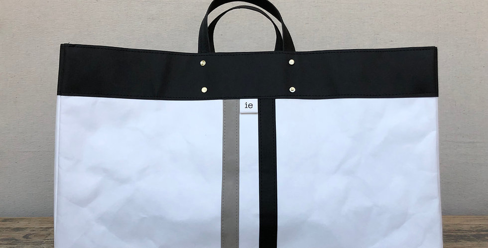 white beach tote with black trim and grey & black railroad stripes