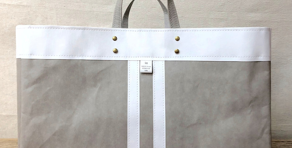 grey beach tote with white trim and white railroad stripes