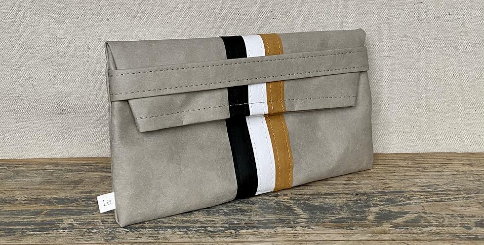 gray clutch with triple stripes