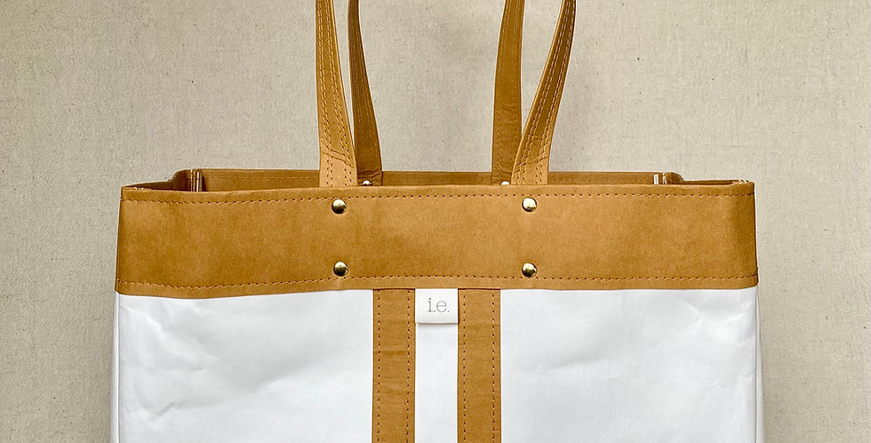 white shopping tote with natural trim and natural railroad stripes