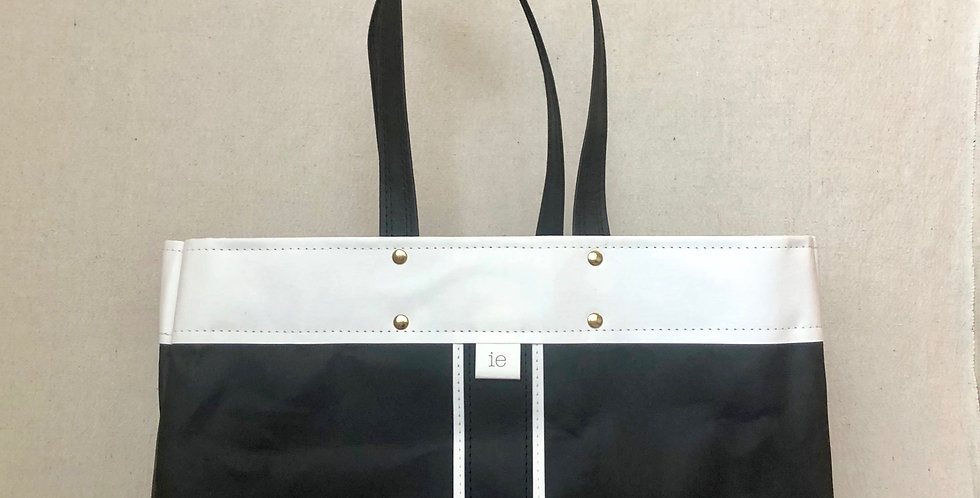 black shopping tote with white trim and black & white surfer stripes