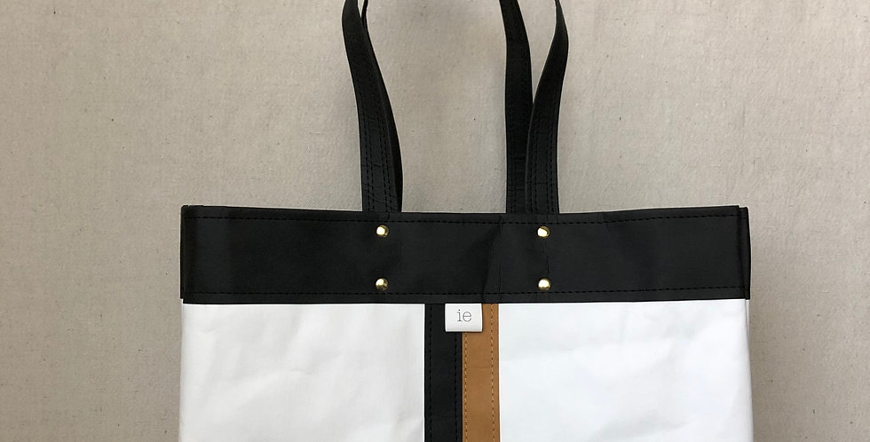 white shopping tote with black trim and black & natural racer stripes
