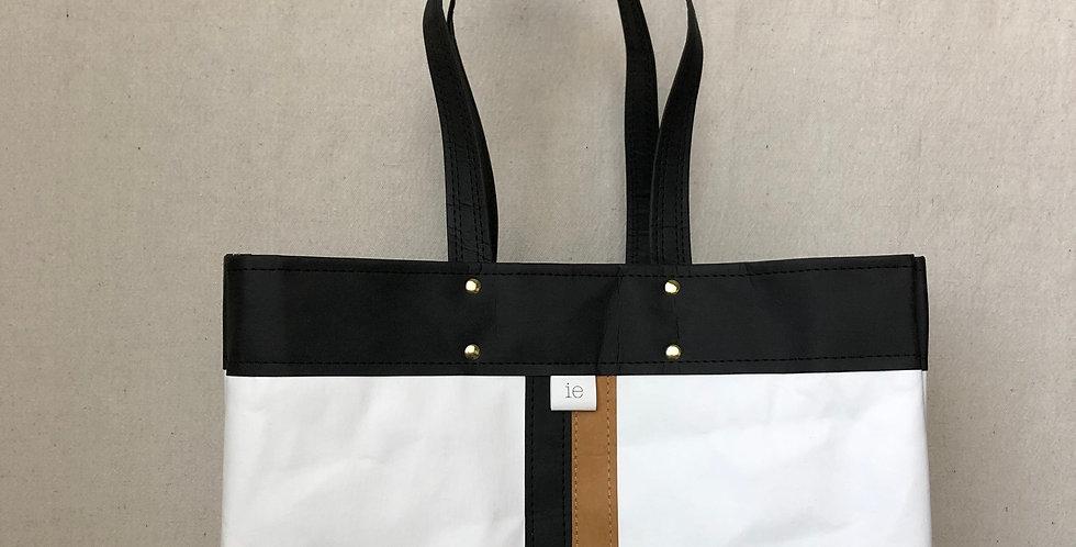 white shoulder bag with black trim and black & natural racer stripes