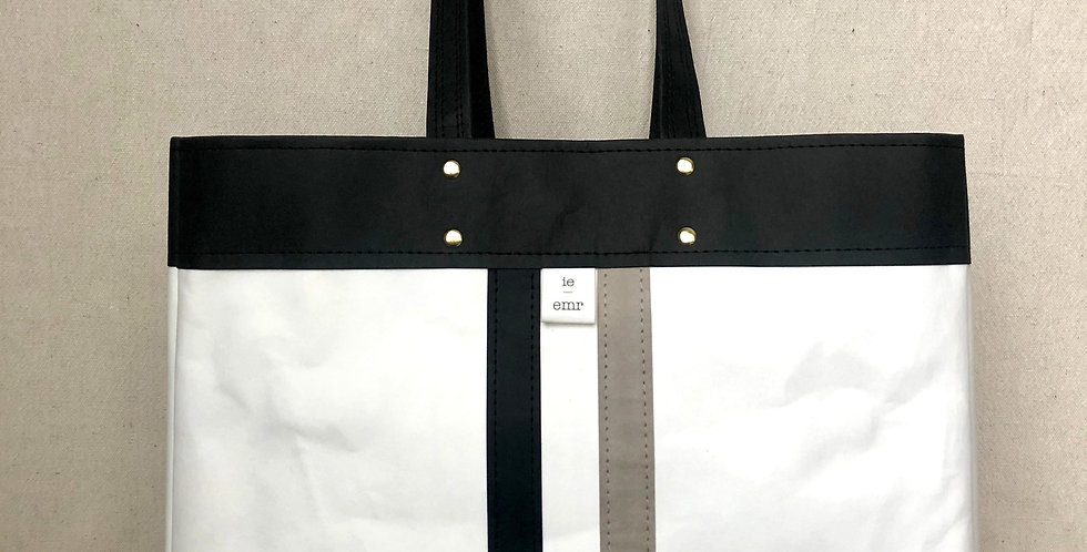 white shopping tote with black trim and black & gray railroad stripes