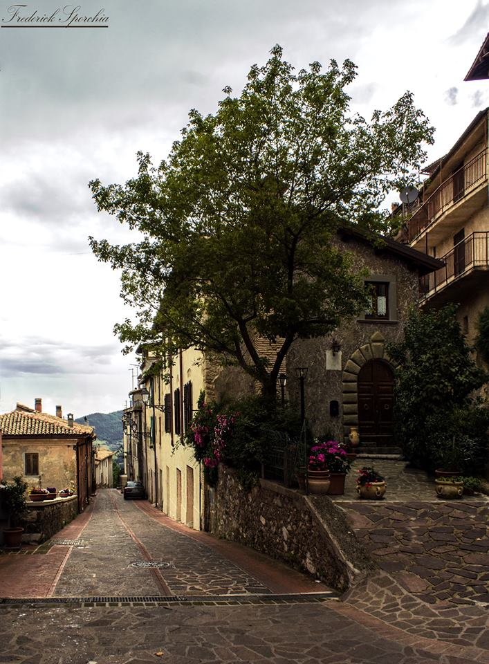 "Vista ""Stradone"" dalla Piazza, a destra ""Casa Melesi"""