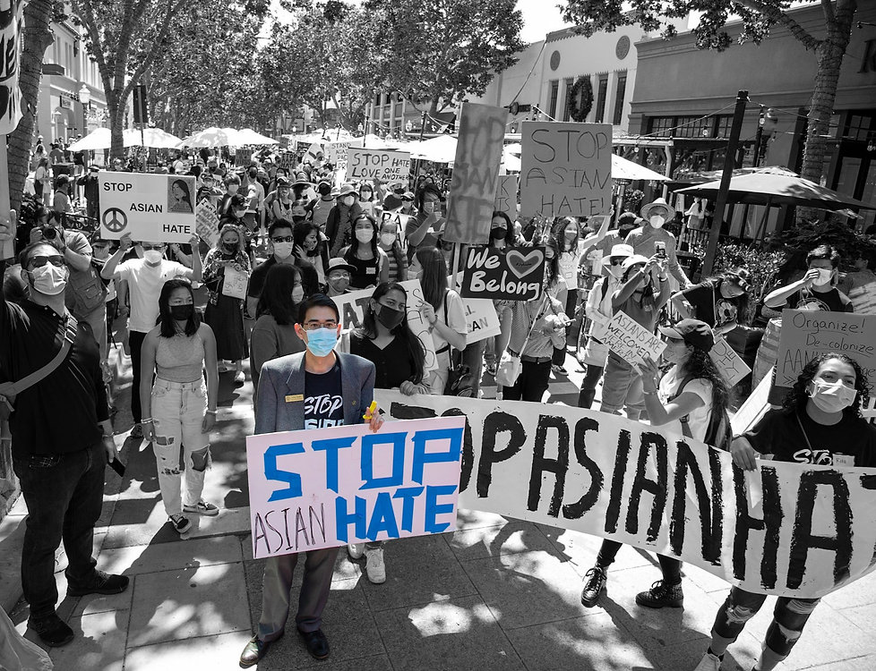 Greg Lin Tanaka marching with protestors during a Stop Asian Hate Rally in Palo Alto.
