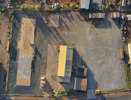 Top down of Pilbara Project Services large yard and wash bay in LIA Karratha