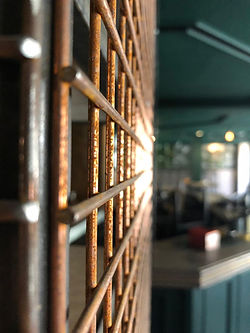 A close up image of the cage used for wine storage inside the entrance of The Green Room