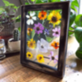 Distressed wooden photo frame with press