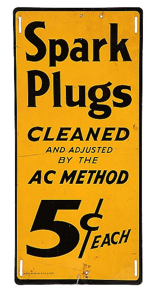 Spark plug cleaning metal sign