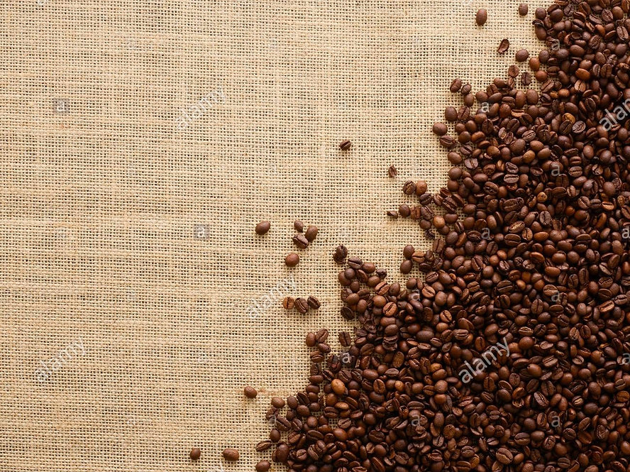coffee-beans-against-a-brown-background-