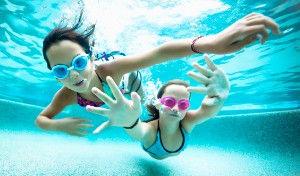 2 girls underwater in a pool.jpg