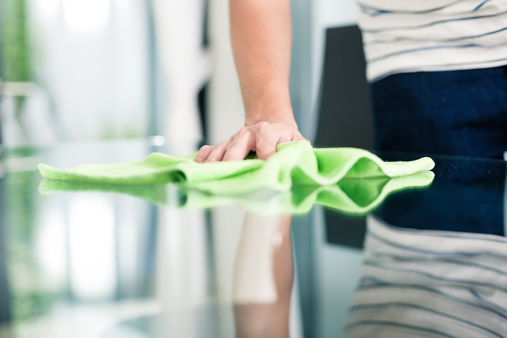 man cleaning counter with cloth
