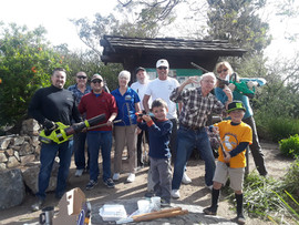 La Mesa lions cleaning and gardening at the outside theater on Mt. Helix. Pictured L - R: President Tyson Eckel, Doug Battey, Kasim, Mary Rynearson, Herb Schaffer, David Shaw, Chuck Bras, Patty Callan,  and Tysons sons Parker and Lincoln.