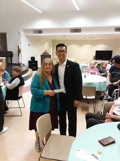 President elect Elbert Kim giving a $1500.00 donation to the Blind Community Center from the La Mesa lions club, May 25, 2019 at their 70th Anniversary.