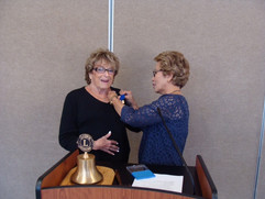 Irene Simon recieving Secretary of the Year from Governor Mercy Walters