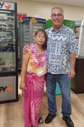 Lion Dr. Sally Lee and Lion David Shaw at the Hawaiian Luau Grand Opening of Dr. Lee's Optometry Office