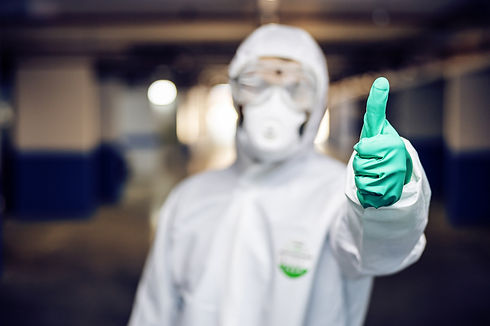 Man in a hazmat putting his thumb up.jpg