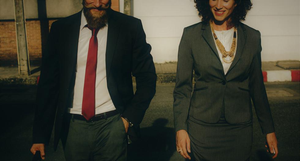 business man and woman walking-sunscreen