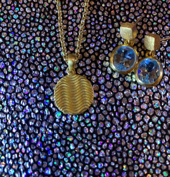 Wave pendant and blue topaz earrings