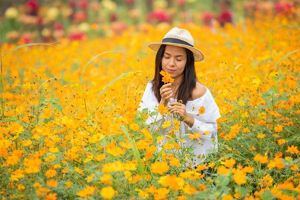 Asian-women-in-yellow-flower-farm.jpg