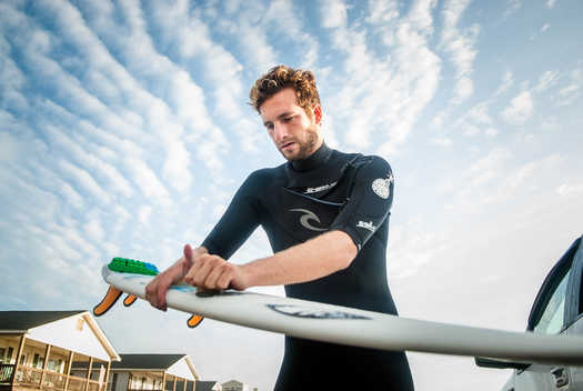waxing a surfboard in Charleston, SC