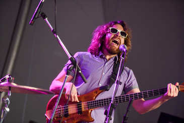 a man playing guitar at a concert in Richmond, VA