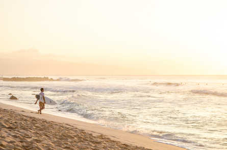 surfing at Banzai Pipeline in Oahu, Hawaii