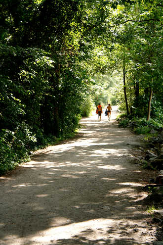 a young couple walking to the river at Belle Isle in Richmond, VA