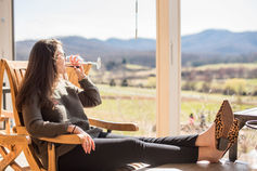 a young woman drinking wine at Pippin Hill Farm and Vineyards