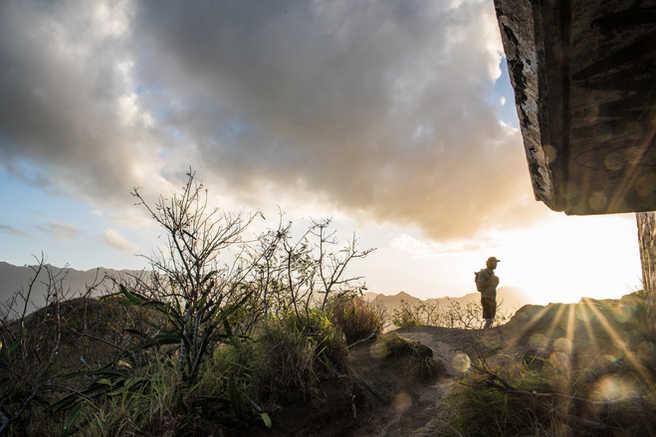 a man hiking in Oahu, Hawaii