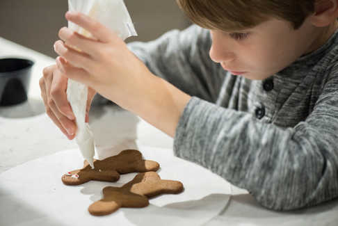 a boy decorating cookies