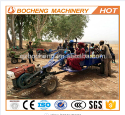 Chinese Power-tiller with it's trailer attached.  They are a handy machine in Africa, and they are easy to maintain.