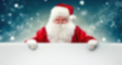 Happy Santa Claus holding blank advertis