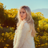 """Crazy"": The Captivating Debut Single from Pop-Rocker Iris"