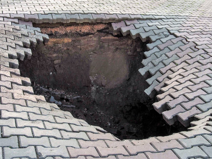 Hanging On: Avoiding sidewalk holes