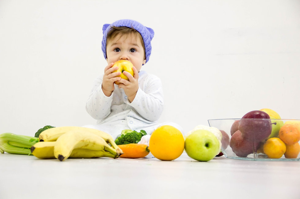 Baby eating fruit.jpg