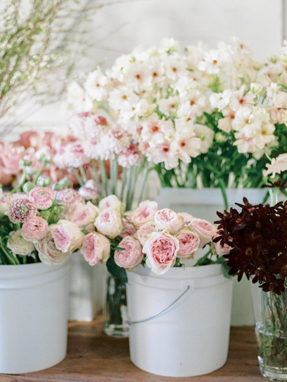 Buckets full of blush and white flowers
