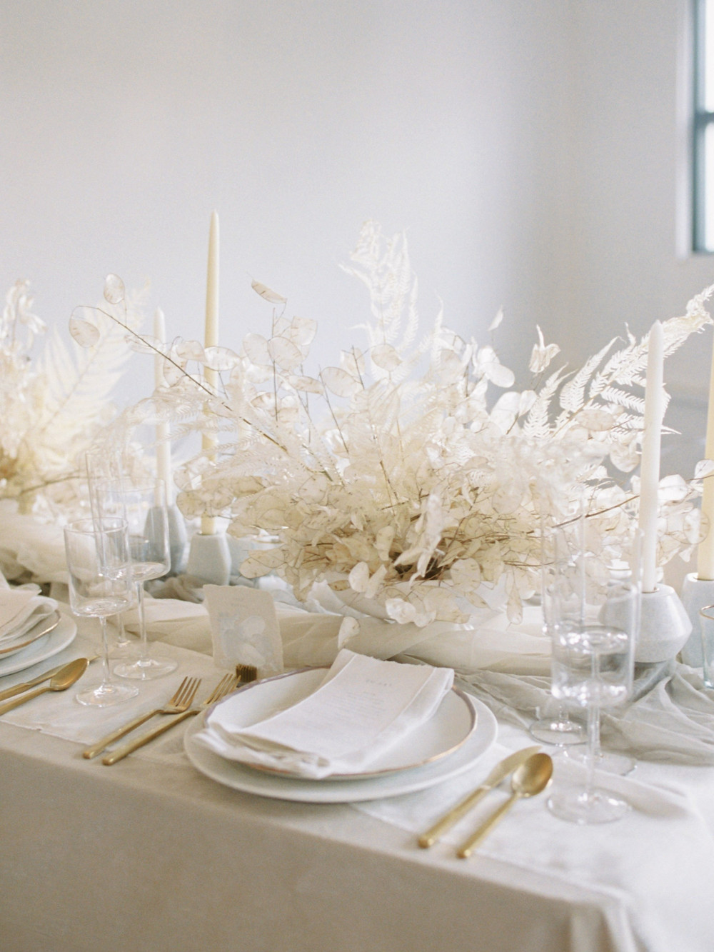 All white centerpiece with lunaria