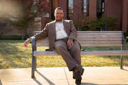 Man posing on a bench